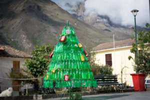 Christmas tree made out of green, plastic bottles.