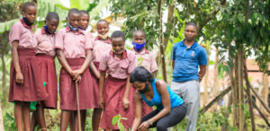 Children planting trees at a school in Mbale